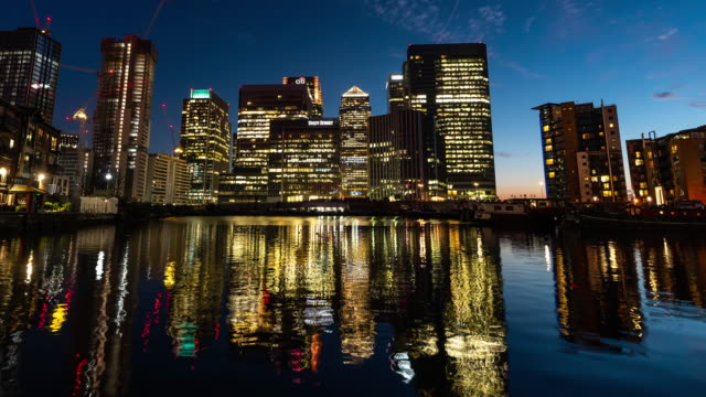 time-lapse: office building skylines skycraper at london canary wharf england uk at night - canary wharf stock videos & royalty-free footage