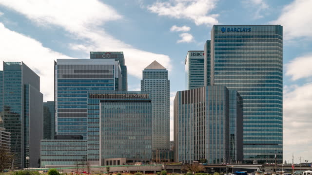 time-lapse: office building skylines skyscraper at london canary wharf england uk - canary wharf stock videos & royalty-free footage