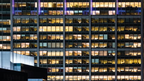 time-lapse office window night in boston city usa for late working concept - massachusetts stock videos & royalty-free footage