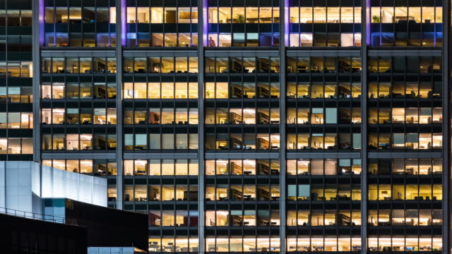 time-lapse office window night in boston city usa for late working concept - office block exterior stock videos & royalty-free footage