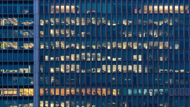 time-lapse office window night in london canary wharf england uk - ward stock videos & royalty-free footage