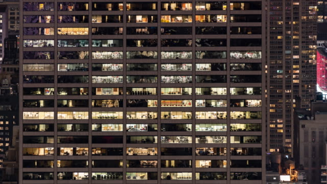 time-lapse office window night in new york city usa for late working concept - office block exterior stock videos & royalty-free footage