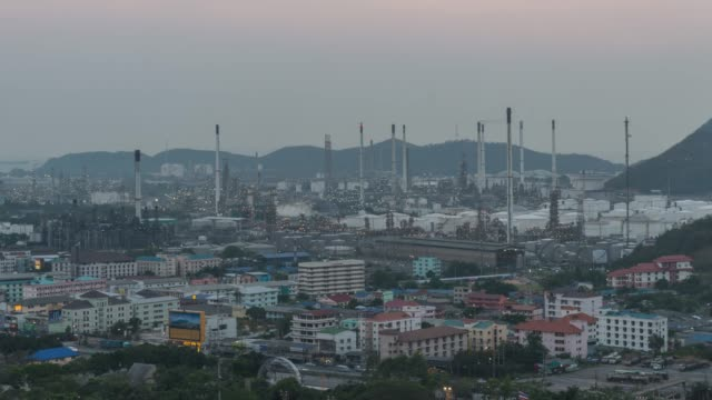 4K Time-lapse: Oil refinery plant petrochemical industry and transport at sunset time, zoom in