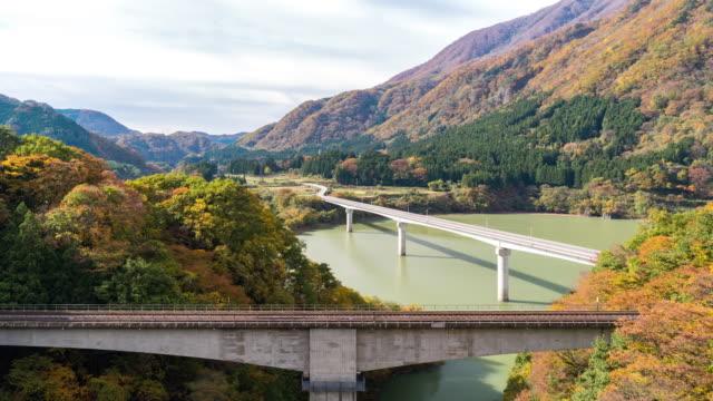 time-lapse: okawa dam lake and aga river viewpoint with red leave landscape, fukushima japan - satoyama scenery stock videos & royalty-free footage