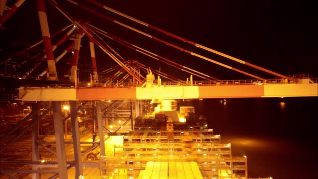 timelapse on board cma cgm sa's benjamin franklin container ship as gantry cranes load shipping containers and day turns to night at the xiamen... - benjamin franklin stock videos & royalty-free footage