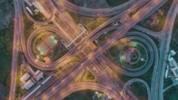 4K Time-lapse or Hyper-lapse Aerial view highway road circle or intersection traffic at night for transportation concept.