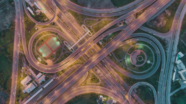 4k time-lapse or hyper-lapse aerial view highway road circle or intersection traffic at night for transportation concept. - traffic time lapse stock videos & royalty-free footage