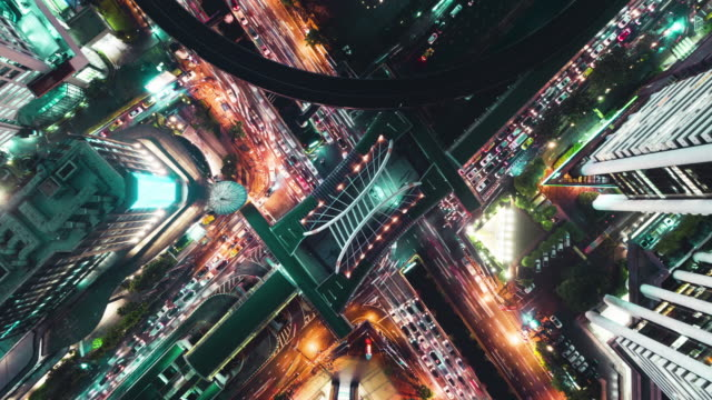 time-lapse or hyper-lapse aerial view highway road junction or intersection traffic at night for transportation concept. - zoom in stock videos & royalty-free footage