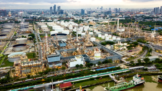 4k timelapse or hyperlapse of aerial of industrial park with oil refinery in asia - chemistry stock videos & royalty-free footage