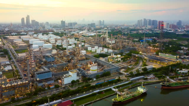 4k timelapse or hyperlapse of aerial of industrial park with oil refinery in asia - petrol stock videos & royalty-free footage