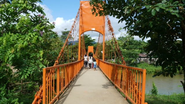 timelapse Orange color bridge at Jung cave in Laos