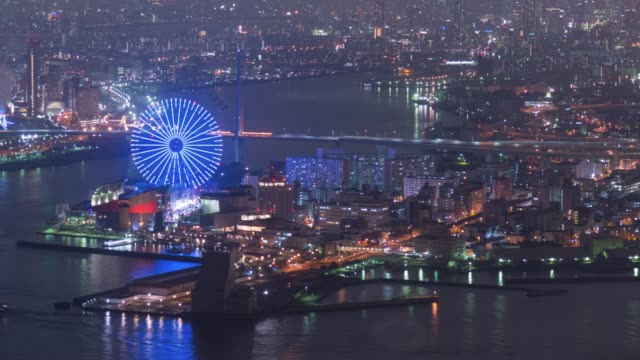 4k time-lapse: osaka bay at beautiful in the night time with fun park at beautiful in japan, zoom out - osaka stock videos and b-roll footage