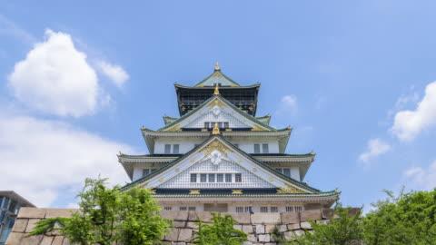 4k timelapse : osaka castle in osaka, japan - art and craft stock videos & royalty-free footage