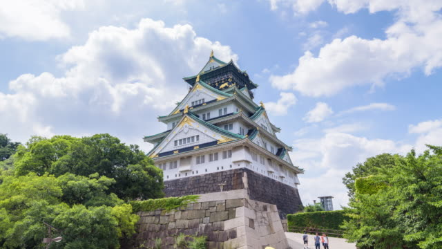 4k timelapse : osaka castle in osaka, japan - castle stock videos & royalty-free footage