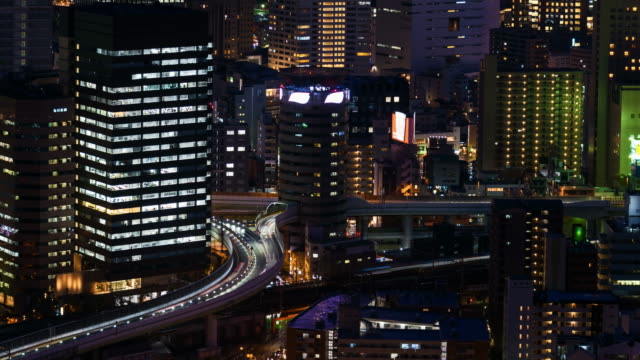 4 K Time-lapse: Cityscape van de Osaka's nachts, panning shot