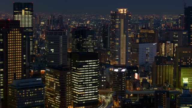 4k time-lapse: osaka cityscape at night, panning shot - panning stock videos & royalty-free footage