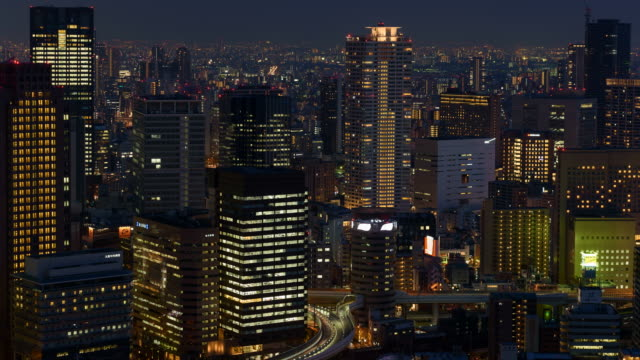 4K Time-lapse: Osaka Cityscape at night with tollway and illuminated building