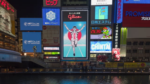 4k time-lapse: osaka shopping street at night with illuminated digital billboard - led light stock videos & royalty-free footage