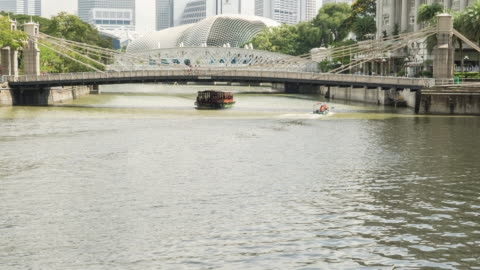 4k time-lapse : outside raffles place motion in city - raffles city stock videos & royalty-free footage