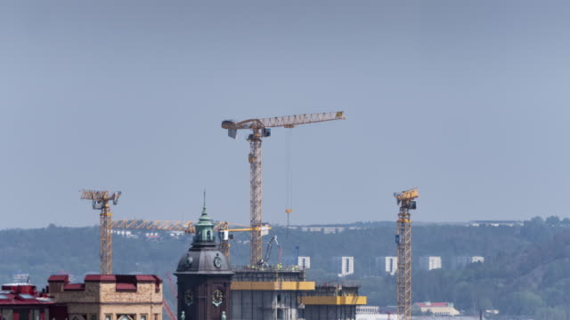 timelapse over gothenburg cityscape with cranes building house - incomplete stock videos and b-roll footage