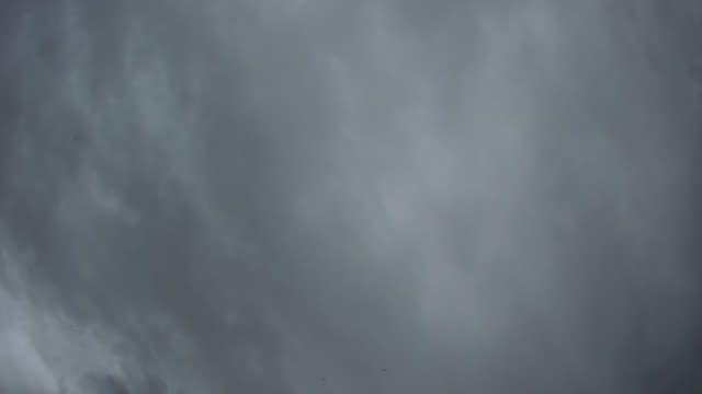Timelapse overhead rain clouds drop rain, UK