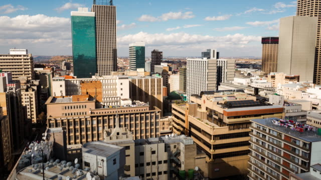 Timelapse pan across the city centre of Johannesburg showing the High Court of South Africa, old Sun International and Carlton Tower