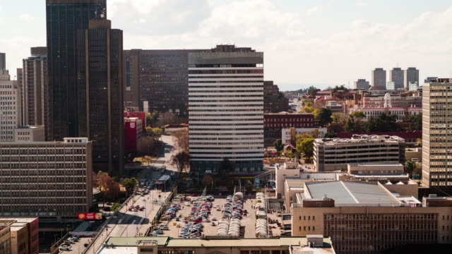 timelapse pan across the city centre of johannesburg showing the gautrain park station, the city counsel and constitution hill - constitution stock videos and b-roll footage