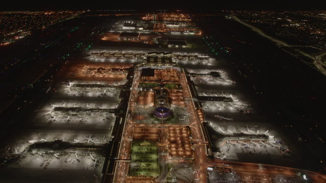 Timelapse: Pan in over Los Angeles International Airport at night.