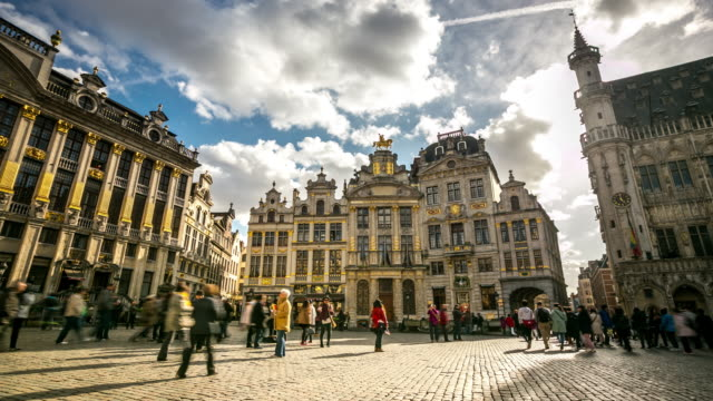 4k time-lapse panning: city pedestrian at grand place brussels belgium - brussels capital region stock videos & royalty-free footage