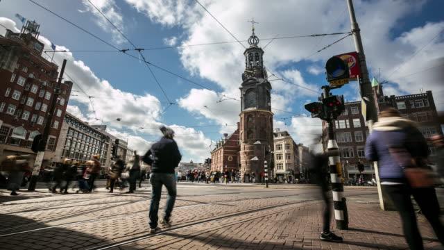 4K Time-lapse panning: City Pedestrian Munttoren Flower market Amsterdam