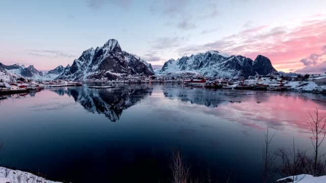 Time-lapse panning of Scandinavian village with surrounded mountain on winter at morning. Reine, Lofoten Islands, Norway
