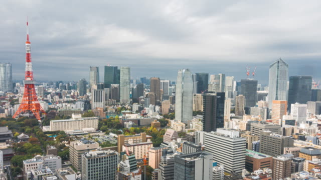 4k time-lapse: panning right view of tokyo tower and tokyo skyline from a skyscraper in tokyo, japan - tokyo midtown stock videos & royalty-free footage