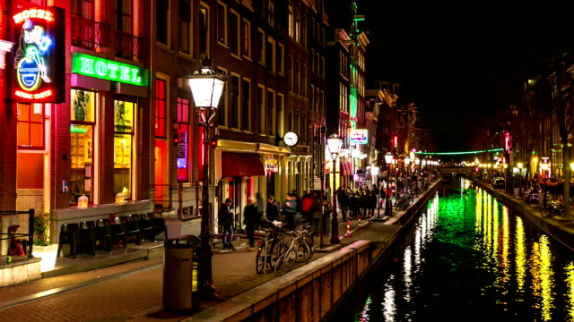 hd time-lapse panning: tourist amsterdam red light district night - amsterdam stock videos & royalty-free footage