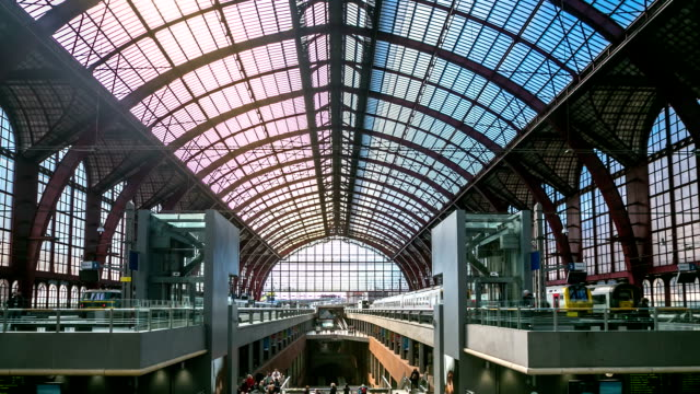 hd time-lapse panning: tourist pedestrian travelling at antwerp central station belgium - station stock videos & royalty-free footage