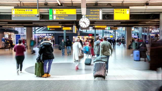 HD time-lapse panning: Traveler at Airport Arrival Terminal Schiphol Amsterdam Netherlands