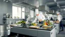 Time-Lapse Panoramic Shot of Big Restaurant Kitchen and Three Chefs Working.