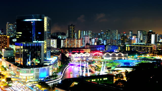 timelapse panoramic view in singapore .zoom out effect - marina bay sands stock videos and b-roll footage