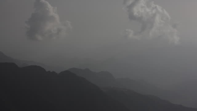 timelapse paraglider swoops over mountains, saudi arabia - adventure stock videos & royalty-free footage