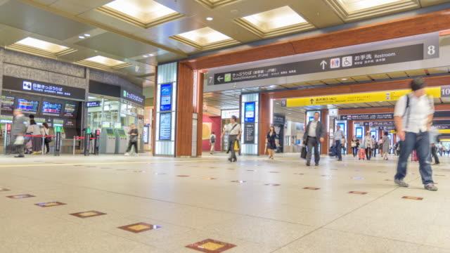 4k timelapse: passengers are walking in kanazawa station - kanazawa stock videos and b-roll footage