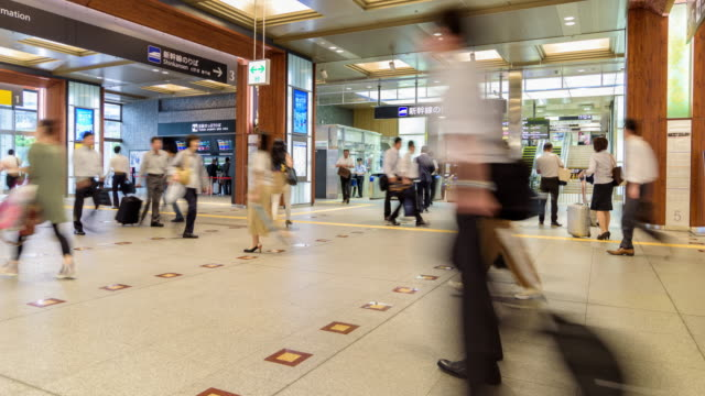 4k timelapse: passengers are walking in kanazawa station - ishikawa prefecture stock videos and b-roll footage