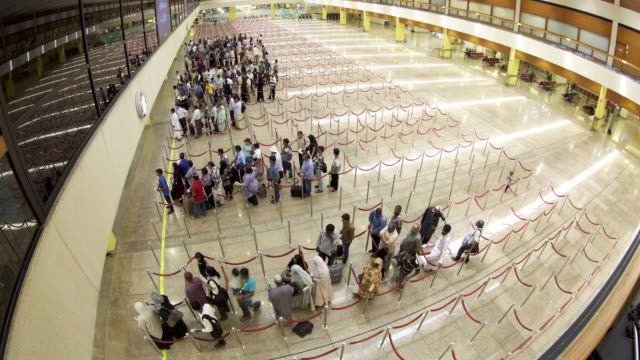 Timelapse passengers move through airport check-in, Dubai