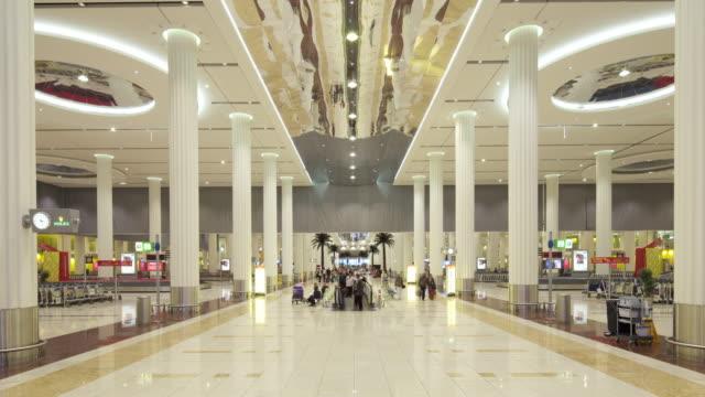 Timelapse passengers move through airport terminal, Dubai
