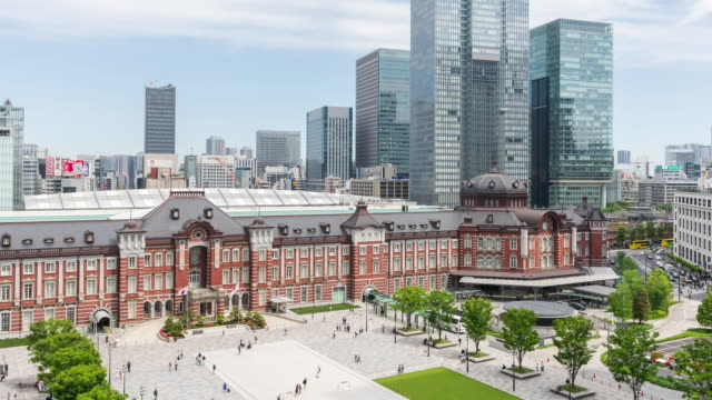 time-lapse: pedestrian and tourist crowded at front of tokyo station, tokyo, japan. zoom out shot - marunouchi stock videos & royalty-free footage