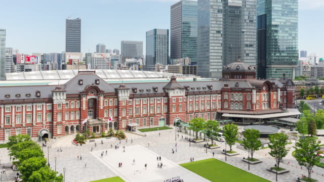 time-lapse: pedestrian and tourist crowded at front of tokyo station, tokyo, japan. - public transport stock videos & royalty-free footage