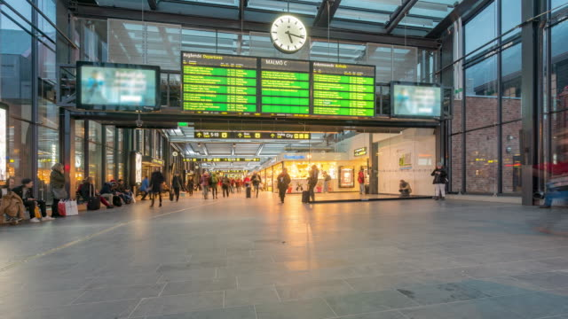 time-lapse pedestrian at malmo station in sweden - railway station stock videos & royalty-free footage