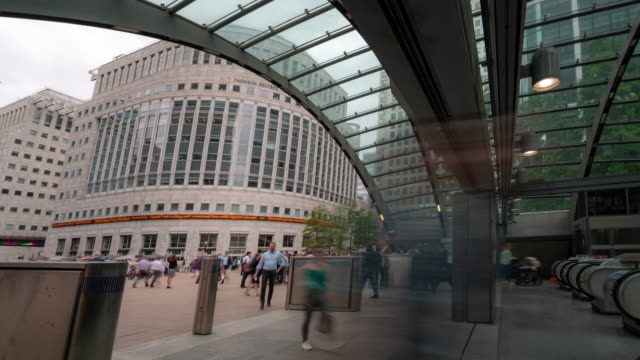time-lapse Pedestrian Commuter Crowd at canary wharf train tube station in London England UK