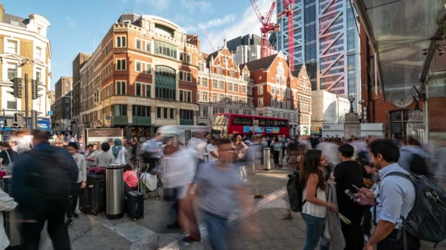 time-lapse: pedestrian commuter crowd at liverpool street downtown in london england uk - high street stock videos & royalty-free footage