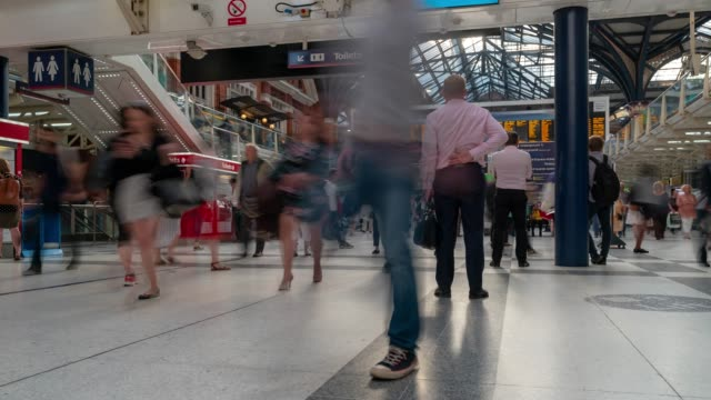 Time-lapse Pedestrian Commuter Crowd at Liverpool street train station ticket hall in London England UK