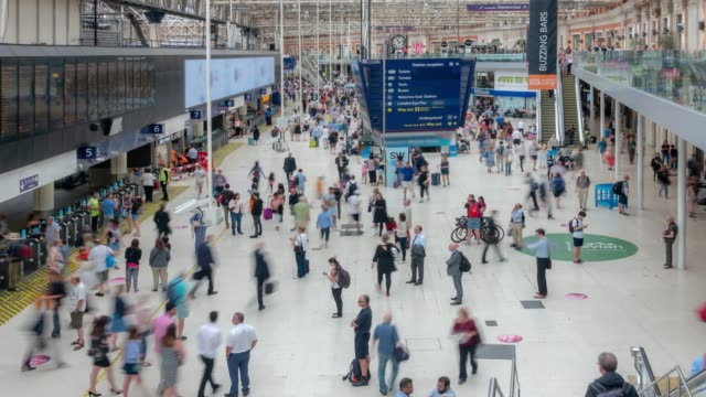 time-lapse pedestrian commuter crowd at london waterloo train station ticket hall in london england uk - ticket stock videos & royalty-free footage