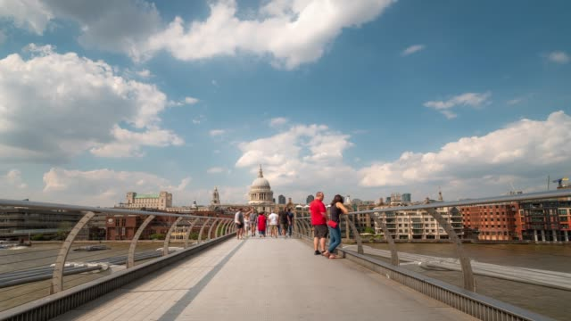 time-lapse: pedestrian commuter crowd at millennium bridge with st paul's cathedral in london england uk - london millennium footbridge stock videos and b-roll footage